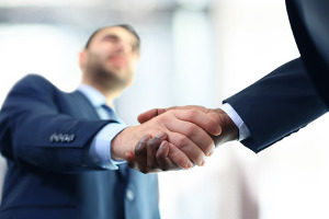 homeowner shaking hands with a Northern VA civil litigation attorney