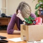 business woman who received a wrongful termination based on her origin packing her belongings