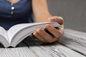 Woman reading the statute of limitations on wrongful termination cases