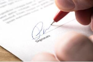 A person signing a settlement agreement for wrongful termination