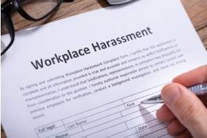 Someone filling out a harassment complaint because of a hostile work environment