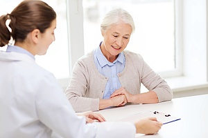 elderly woman with doctor discussing medicare