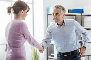 employer shaking hands with employee over the fair labor standards act