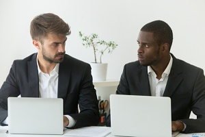 two men seeing discrimination in the workplace