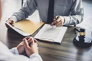 an employee speaking with an attorney regarding overtime pay compensation