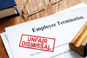 employee reading papers with attorney of wrongful termination