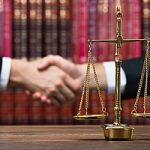 a defendant shaking hands with an attorney after researching how to select a criminal defense attorney